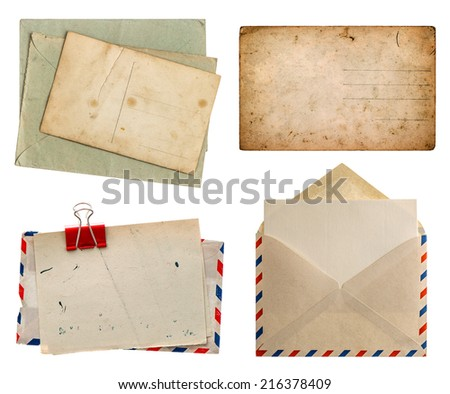 air mail envelope and aged postcards isolated on white background. retro design papers - stock photo