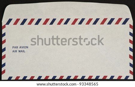 air mail envelope isolated on black background par avion - stock photo