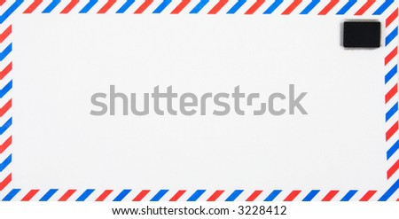 Air Mail envelope with electronic, silicon chip as stamp, conceptual shot for email. - stock photo