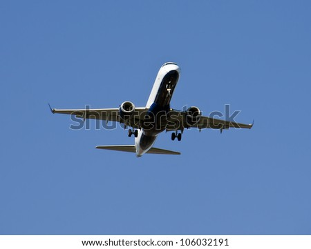 Air plane is flying,  With blue sky