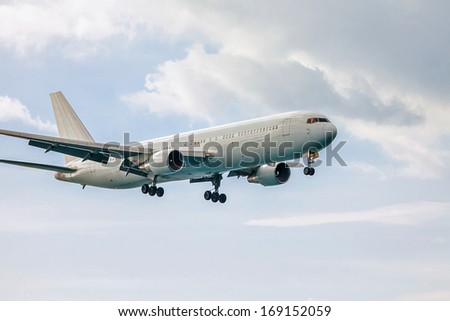Air plane on a background of the sky with clouds  - stock photo