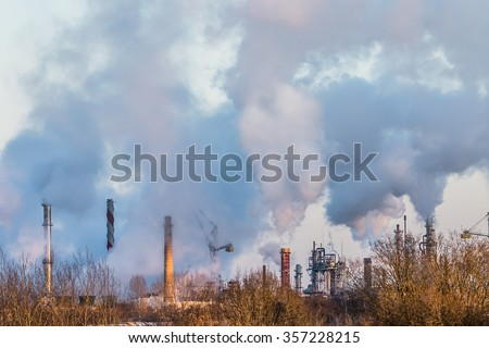 Air pollution by smoke coming out of many factory chimneys. Achema factory is a leading producer of nitrogen fertilizers and chemical products in Lithuania and the Baltics - stock photo