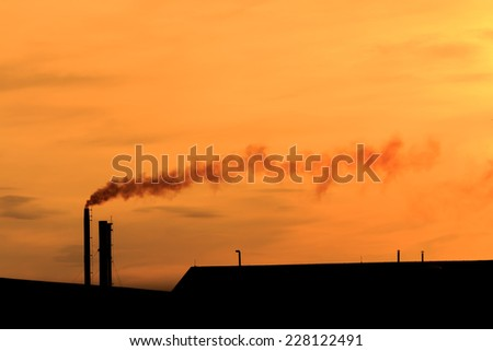 Air pollution caused by the factory. - stock photo
