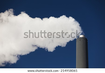 Air pollution, Chimney polluting the environment with smoke. - stock photo