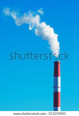 Air pollution. Dirty smog from big factory chimney.  - stock photo