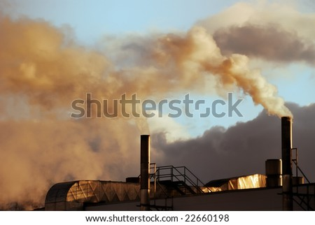 Air pollution from a factory - stock photo