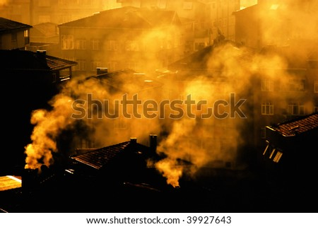 air pollution image of houses and smoke