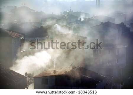 air pollution image of houses and smoke in winter - stock photo