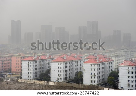 air pollution over the town - stock photo