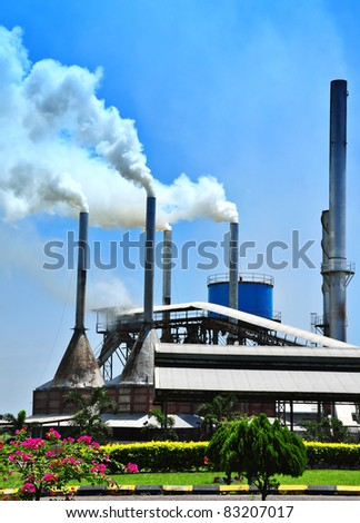 air pollution produced by the palm oil mill - stock photo