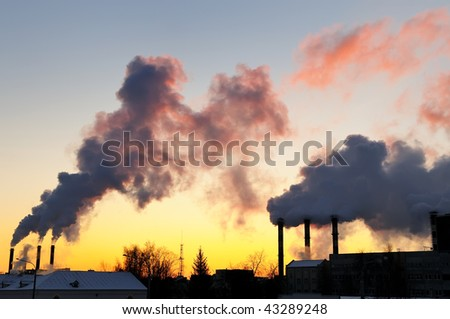 air pollution with columns of smoke emitted from factory chimneys