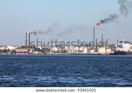 Air polution generated by oil refinery in Havana, Cuba. Flames and smoke. - stock photo
