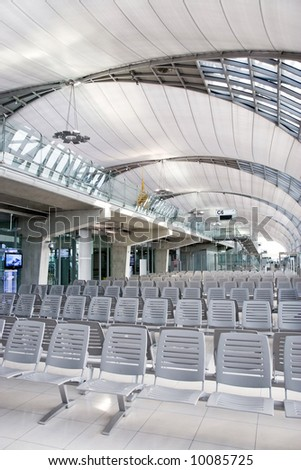 Air port waiting room with tall ceiling architecture. - stock photo
