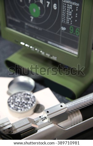 air rifle and 10m target monitor on sports competition - stock photo