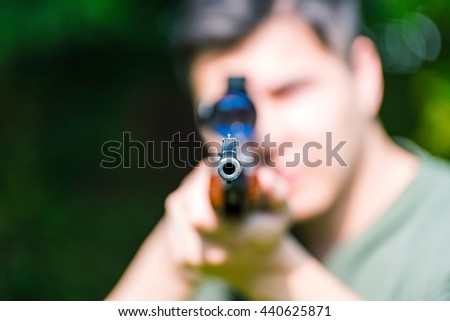 Air rifle with out of focus hunter - stock photo