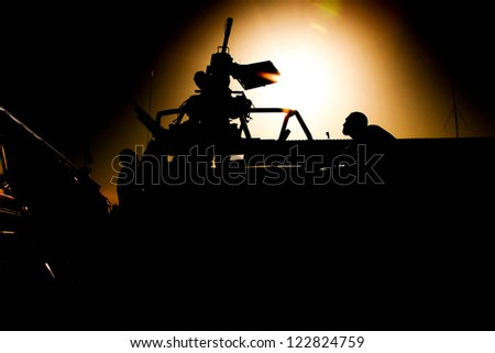 Air Silhouette of soldiers in Afghanistan - stock photo