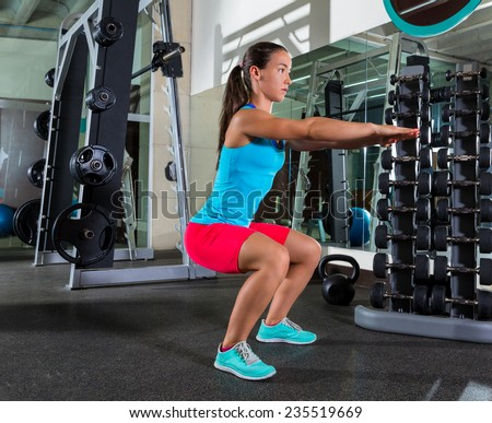 Air squat woman workout exercise at gym - stock photo