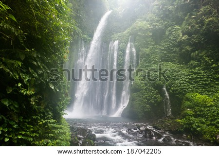 Air Terjun Tiu Kelep waterfall near Rinjani, Senaru, Lombok, Indonesia, Southeast Asia - stock photo