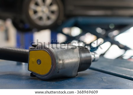 Air tools at car garage for checking a car brake system and wheel and tire. - stock photo