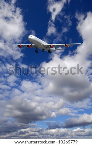 Air travel - Plane is flying in blue sky with clouds - stock photo