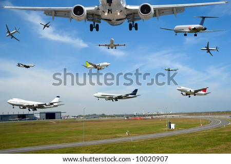 Air travel - Plane traffic in airport at rush hour - stock photo