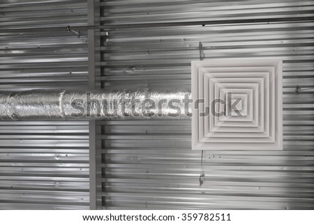 Air Ventilating tube and louver in building - stock photo