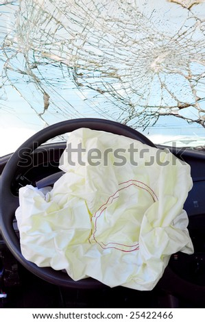 Airbag deployed with a smashed windshield. - stock photo