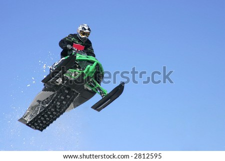 airborne snowmobiler - stock photo