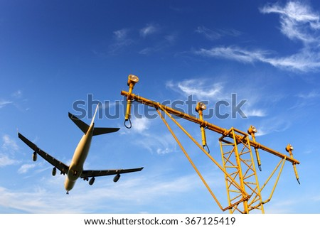 Airbus A340 civil airplane in airport above landning lights. - stock photo