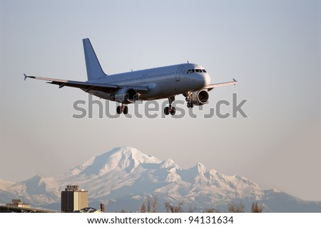 Airbus A-320 with Mt. Baker in the background - stock photo