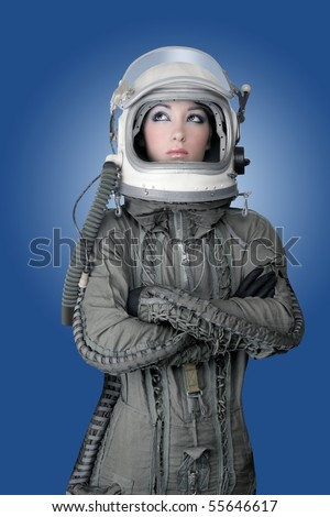 aircraft  astronaut spaceship helmet woman fashion portrait over blue [Photo Illustration] - stock photo