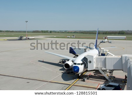 Aircraft being loaded at an airport - stock photo