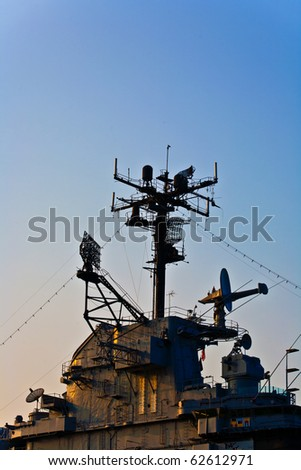 aircraft carrier in sunset - stock photo