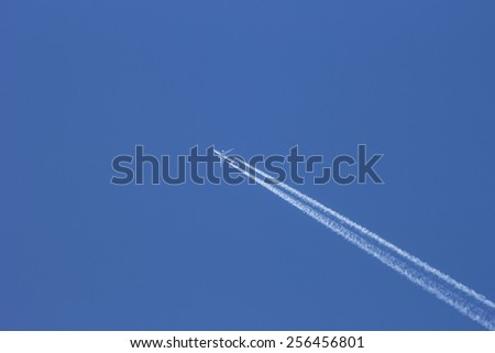 Aircraft condensation strip of blue sky - stock photo