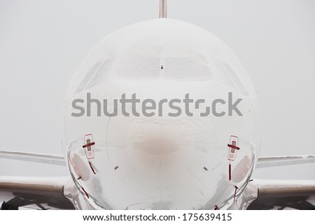Aircraft covered by snow after a snow storm. - stock photo