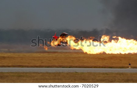 Aircraft Crashing and On Fire - stock photo