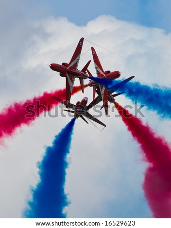 Aircraft crossover by the Red Arrows flying display team - stock photo