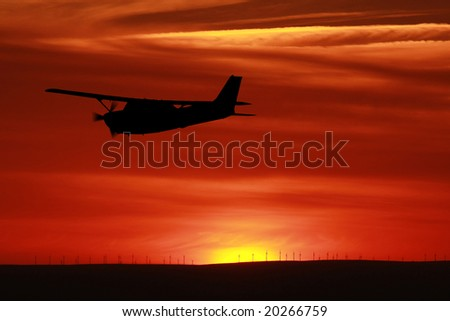 Aircraft flying into the sunset