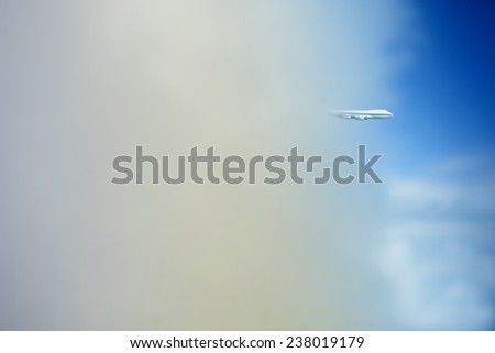 Aircraft flying out of cloud - stock photo