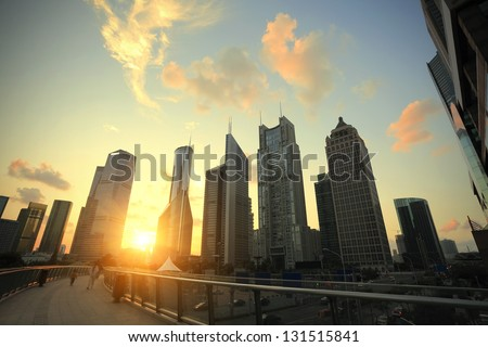 Aircraft flying over the modern city buildings over in Shanghai - stock photo