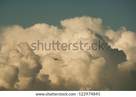 Aircraft flying through storm clouds.