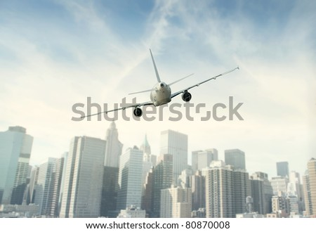 Aircraft flying towards a city