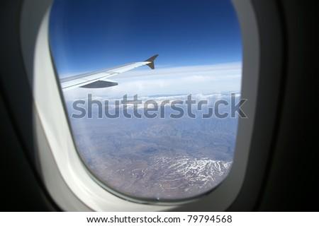 Aircraft illuminator window view - stock photo