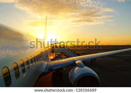 aircraft in airport at sunset - stock photo