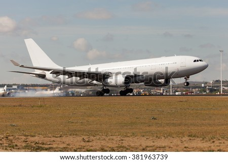 Aircraft in movement. White airplane makes landing on Airport Runway. - stock photo