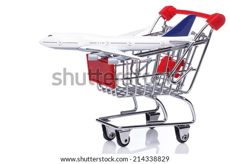 Aircraft in shopping trolley over white background