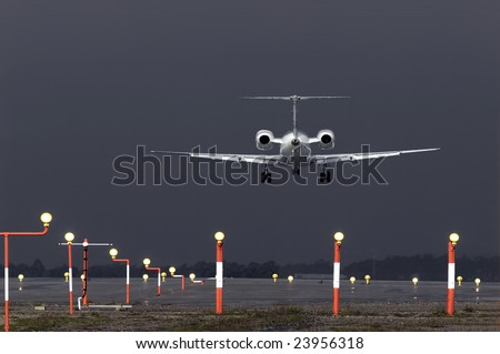 Aircraft landing during a violent rain storm. - stock photo
