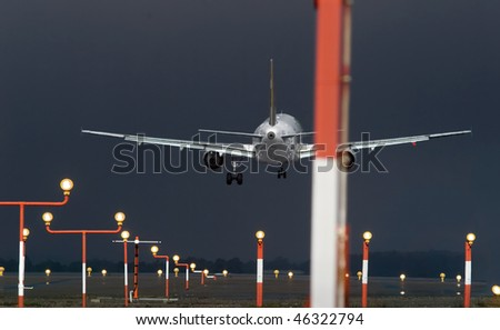 Aircraft landing during a violent rain storm - stock photo