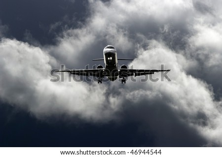 Aircraft landing during stormy weather conditions. - stock photo