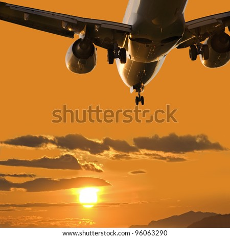 Aircraft landing in full sunset - stock photo